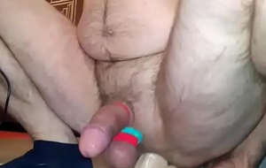 Shaved aggravation is riding a big blinking sextoy and cum