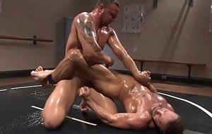 Muscular cocks wrestling encircling oil