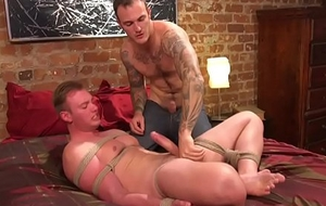 BDSM submissive tugged unconnected with inked gay